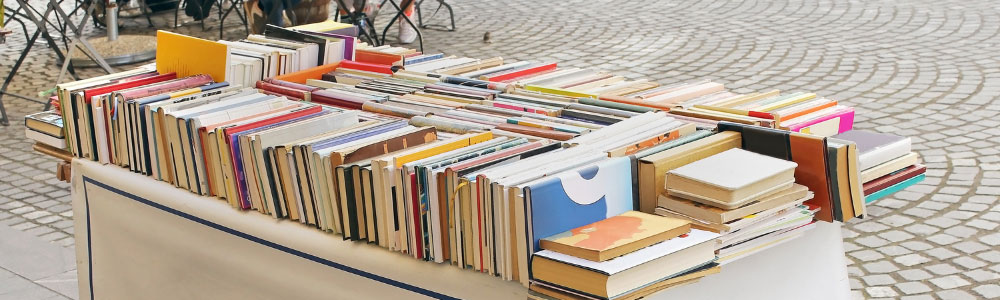 image of table full of used books for sale